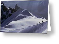Hikers Follow Paths Across The Snow Greeting Card