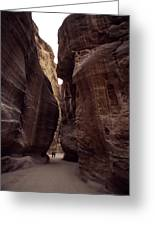Hikers In The Siq Canyon Leading Greeting Card by Gordon Wiltsie