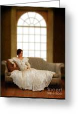 Lady Sitting On Sofa By Window Greeting Card