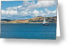 Luxury Yacht Sails In Blue Waters Along A Summer Coast Line Greeting Card