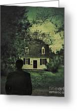 Man In Front Of Cottage Greeting Card