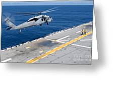 N Mh-60s Sea Hawk Helicopter Lifts Greeting Card