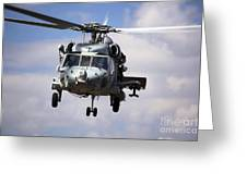 Navy Pilots In A Sh-60f Seahawk Conduct Greeting Card