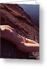 Nude Woman Lying On Rocks By The Water Greeting Card