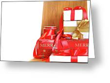 Pile Of Gifts On Wooden Chair Against White Greeting Card