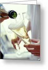 Pouring Champagne Greeting Card by David Munns