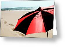 Red And Black Umbrella On The Beach With Footprints Greeting Card