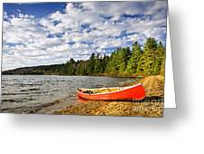 Red Canoe On Lake Shore Greeting Card