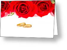 Red Roses And Wedding Rings Over White Greeting Card
