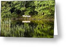 Rowboat Moored On The Bank Of A Lake Greeting Card