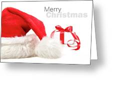 Santa Hat And Gift With Red Bow Greeting Card