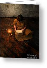 Schoolgirl Sitting On Wood Floor Reading By Candlelight Greeting Card