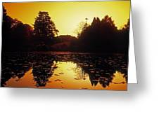Silhouetted Home And Trees Near Water Greeting Card