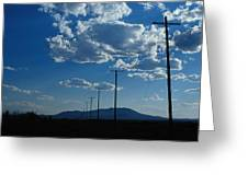 Silhouetted Telephone Poles Under Puffy Greeting Card