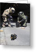 Soldiers Dressed In Bomb Suits Examine Greeting Card