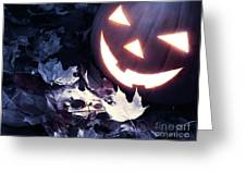 Spooky Jack-o-lantern On Fallen Leaves Greeting Card