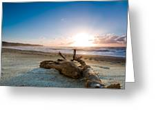 Sunset Over A Misty Beach Greeting Card