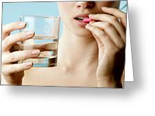 Taking Pill Greeting Card by Mauro Fermariello