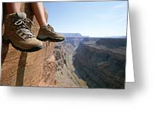 The Boot-shod Feet Of A Hiker Dangle Greeting Card