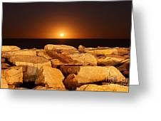 The Moon Rising Behind Rocks Lit Greeting Card