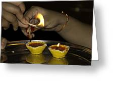 Trying To Light An Oil Lamp That Has Gone Out Greeting Card