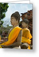 Two Buddha Statues Wrapped In An Orange Scarf  Greeting Card