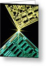 Two Circuit Boards Meeting At A Spot Of Light. Greeting Card by Tony Craddock