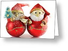 Two Father Christmas Decorations Greeting Card