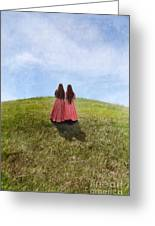 Two Girls In Vintage Dresses Walking Up Grassy Hill Greeting Card