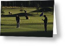 Two People Play Golf While Elk Graze Greeting Card