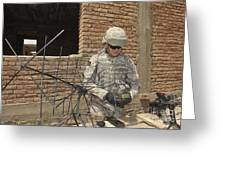 U.s. Army Soldier Configures Greeting Card