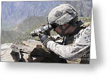 U.s. Army Soldier Monitors An Afghan Greeting Card