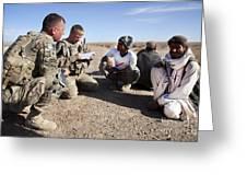 U.s. Army Soldiers Speak With Elders Greeting Card