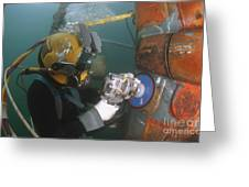 U.s. Navy Diver Uses A Grinder To File Greeting Card by Stocktrek Images