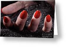 Woman Hand With Red Nail Polish Buried In Black Sand Greeting Card