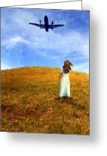 Woman In Field Looking Up At An Airplane Greeting Card