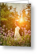 Woman Staning Sideways In Garden At Sunset Greeting Card