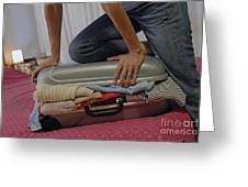 Woman Trying To Close Overflowed Suitcase On Bed Greeting Card