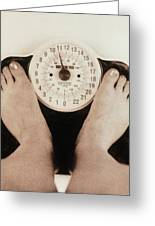 Woman's Feet On A Set Of Weighing Scales Greeting Card