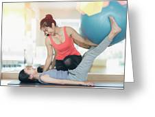 Asian Woman Fitness Coach Teach Her Student For Rubber Ball Exer Greeting Card