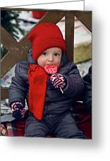 Baby In Red Hat Sits On A Bench In The Street With Candy Greeting Card