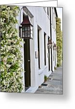 Colonial Home Exterior With Vertical Plants And Old Lanterns Displayed On The Side Of Home Greeting Card