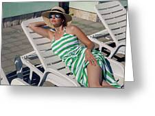 Girl Lies On A Chaise Longue In A Green Striped Dress Greeting Card