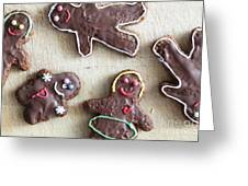 Handmade Decorated Gingerbread People Lying On Wooden Table Greeting Card