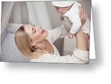 Happy Mother With Her Baby Greeting Card