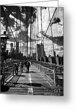 people walking over the brooklyn bridge between cables towards lower manhattan New York City USA Greeting Card