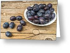 Plate Full Of Fresh Plums On A Wooden Background Greeting Card