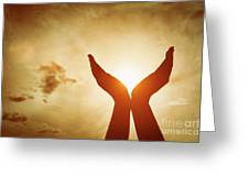 Raised Hands Catching Sun On Sunset Sky. Concept Of Spirituality, Wellbeing, Positive Energy Greeting Card