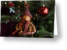 Silly Old Monkey Toy In A Child Hands Under The Christmas Tree Greeting Card