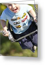 Young Boy Smiling Swinging In A Swing Greeting Card